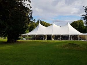 Marquee types explained - A new century marquee with clear walls erected in a garden for a wedding marquee hire