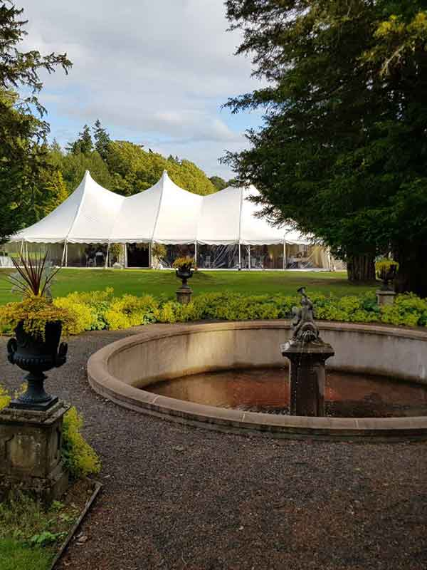 white marquee hire tent standing in a garden in Scottish Borders