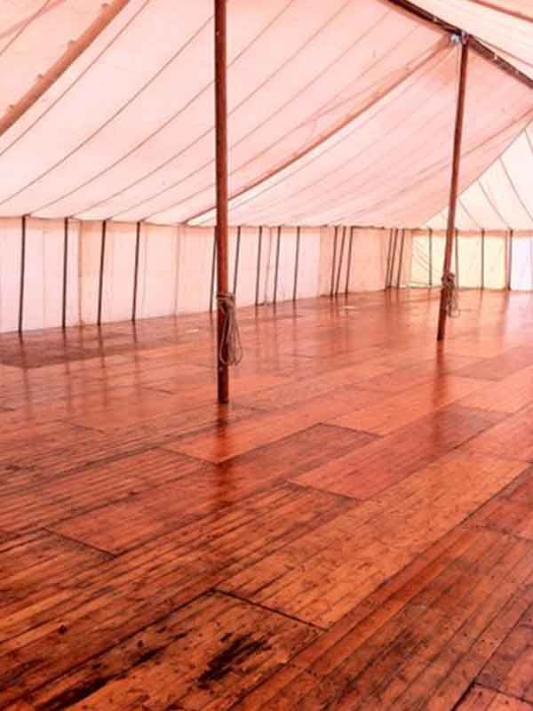 Marquee-wooden-flooring-in-a-traditional-pole-tent-marquee