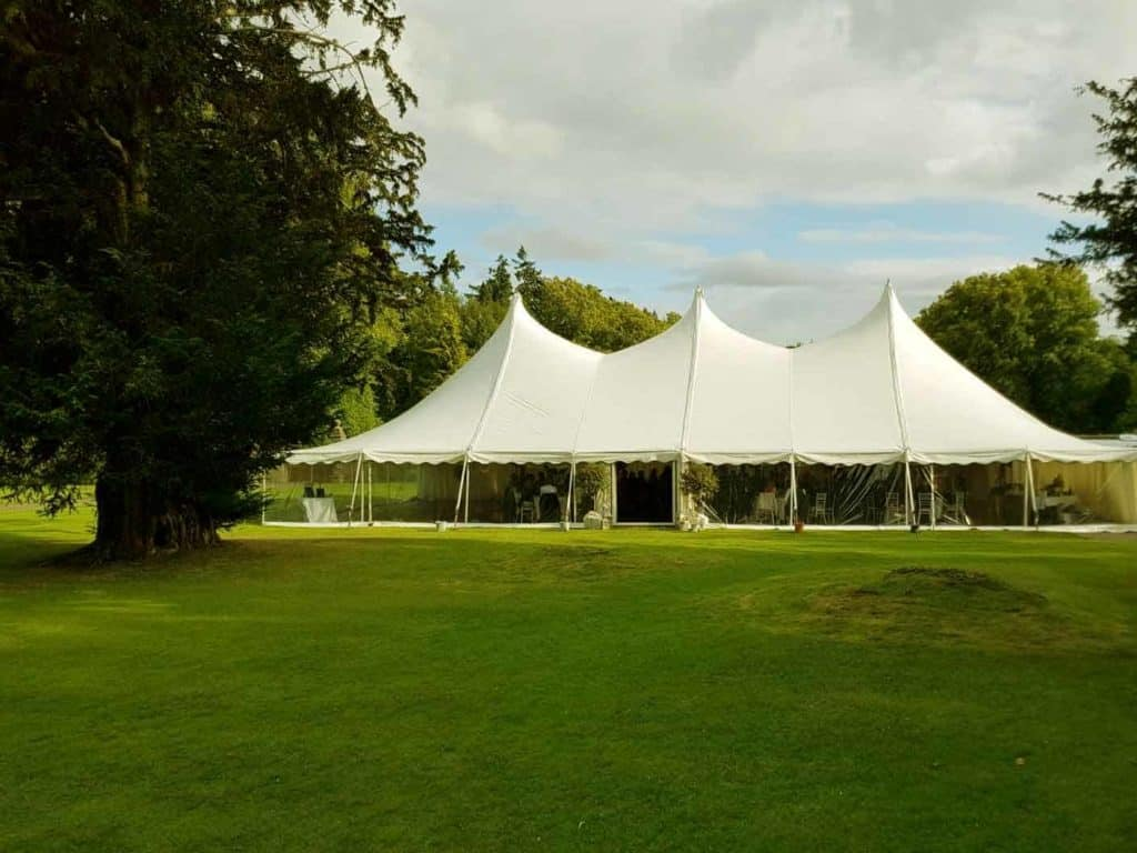marquee hire Scotland tent in a field with blue sky and clouds