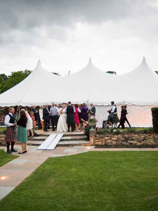 Bride standing outside a wedding marquee hire in Edinburgh