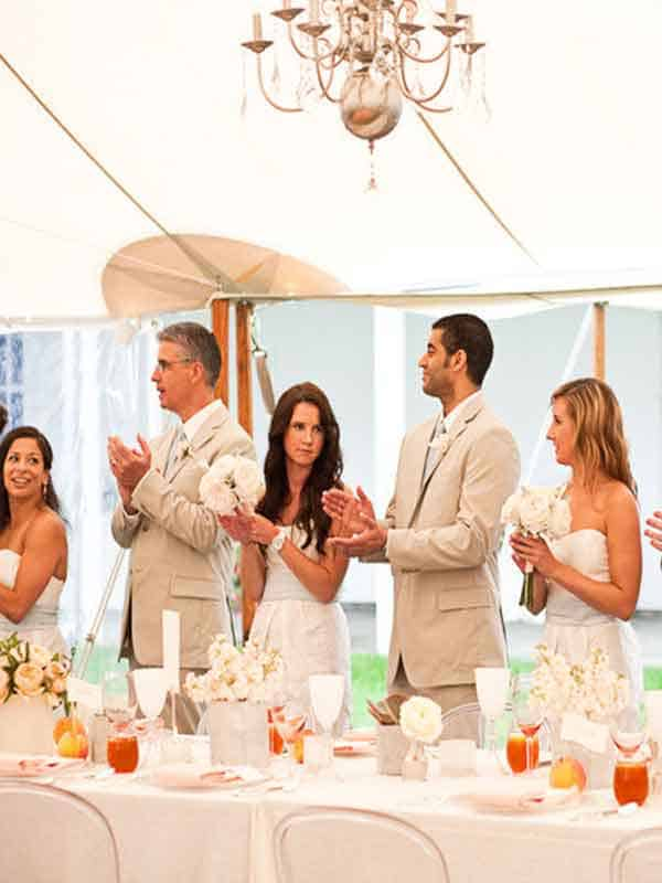 Guests clapping at a wedding in a marquee hire Edinburgh traditional marquee