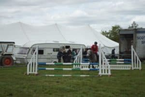 horse trials at an agricultural show with marquee in the background
