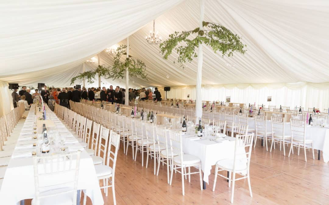 wedding marquee tastefully decorated waiting for the bride and groom to arrive