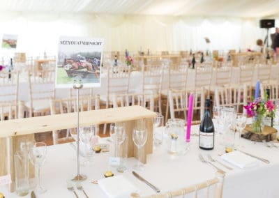 internal shot of tables and chairs inside a wedding marquee