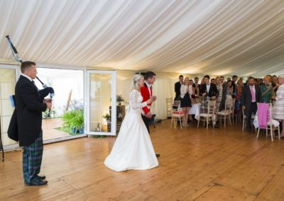 bride and groom arriving at the wedding marquee