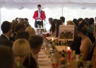 The Groom giving his speech in front of guests in a wedding marquee hire