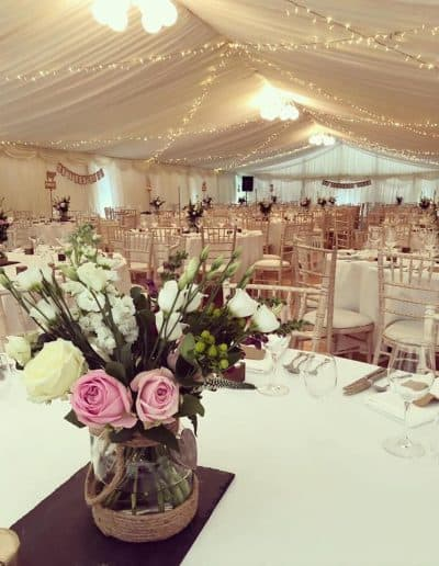 Floral decorations in a wedding marquee hire in East Lothian Scotland